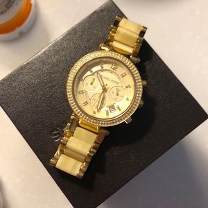 Gold watch with chrystal accents